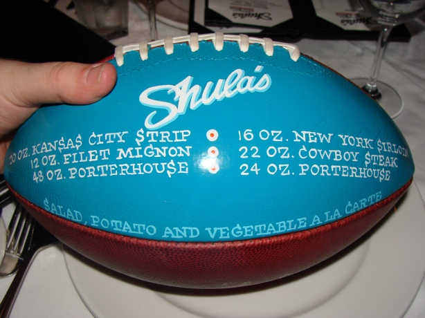 The meat menu is painted on a genuine NFL football