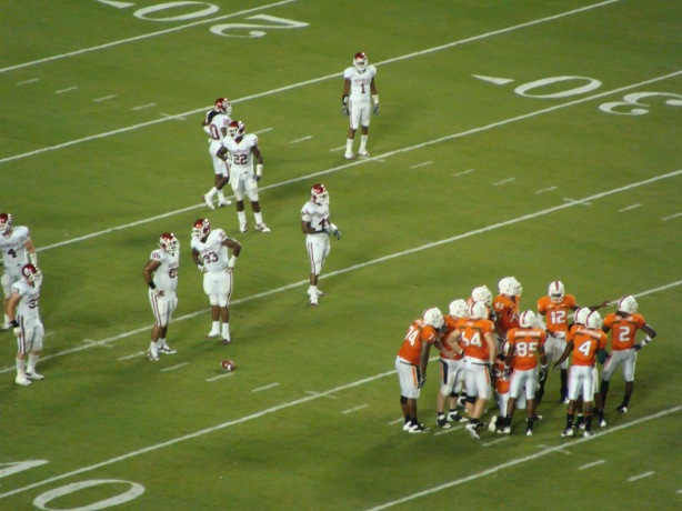 Huddle up Hurricane style - some future NFL playaz in that U huddle